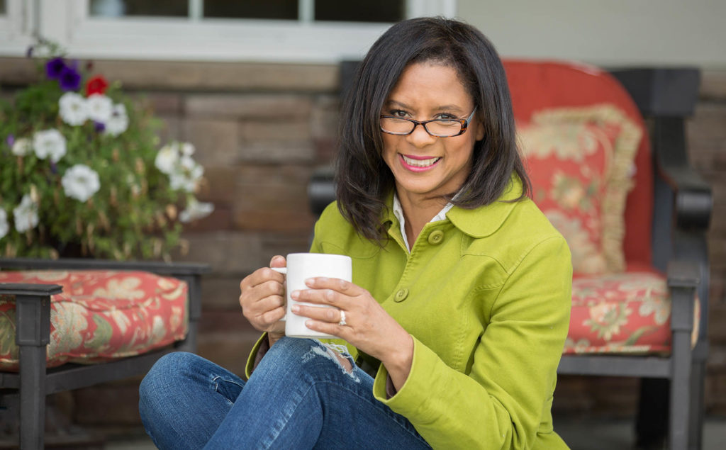Sheila Qualls - Smiling with Cup of Coffee