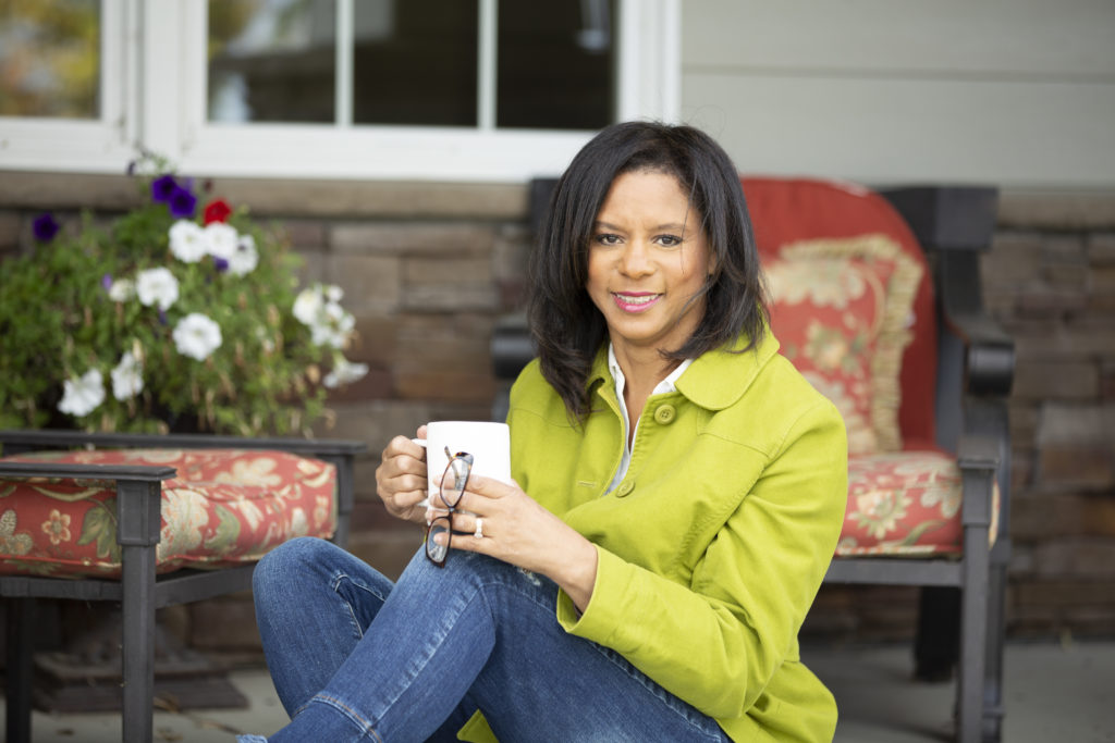 Sheila Qualls Sitting with Cup of Coffee
